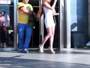 Ravishing redhead teen with wonderful legs upskirt outside