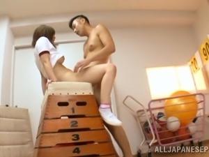 Sporty Japanese girl Mizuki enjoys sucking and riding two cocks