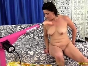 Horny granny gets naked and sucks and bite a machine dildo