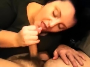 Chubby brunette with huge boobs sucks and strokes a fat dick