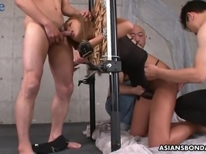 Lewd Japanese whore gets locked in stocks and fucked from behind