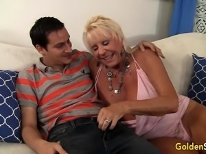 Mature blonde gives blowjob to a younger guy he massages