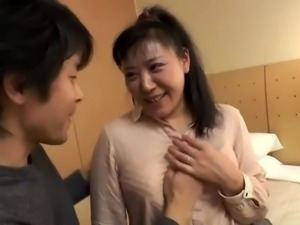Busty Japanese mom has a young man banging her hairy peach