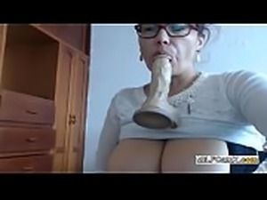 Mature big tits playing with dildo