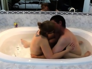 Curvy amateur milf engages in wild sex action in the hot tub