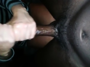 Amateur wife uses her hands and a toy to please a black cock