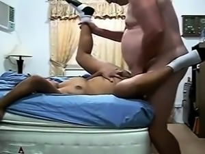 Chunky Asian mom enjoys the pussy drilling action on the bed
