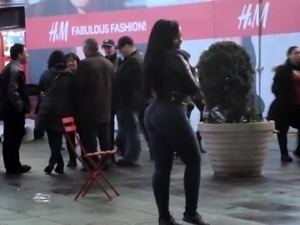 Street voyeur chases a slender black babe with a perfect ass