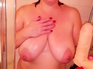Beauty with big natural boobs takes a shower