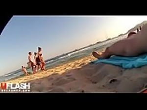 Girls enjoy nude guy view on Beach