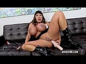 Ava Devine pounds her tight ass with a huge dildo
