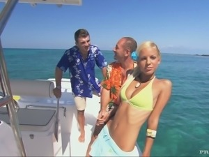 Naughty blond angel is getting two hard cocks on the yacht