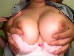 Big breasted Oriental milf gets her hairy peach drilled hard