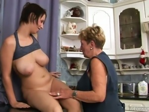 Brunette lesbian gets her cunt licked by a short-haired mature bitch