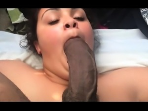 Curvy amateur brunette takes a big black cock in her mouth