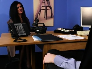 Office babe gets on her knees to tug cock
