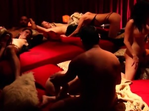 Swinger couple fucking in the middle of the room