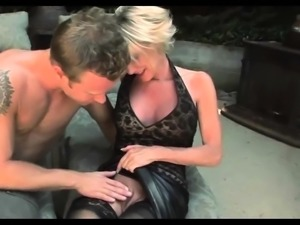 Busty blonde hottie in stockings does a striptease outdoor