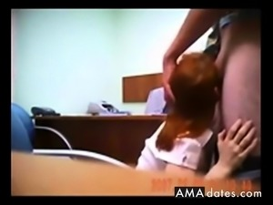 Hidden cam catches redhead in quick office fuck