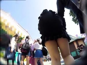 Sweet Oriental schoolgirl in uniform voyeur upskirt outside