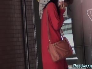Asian slut pees on public street