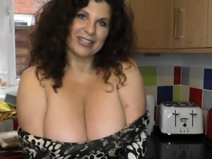 Brunette mature woman with big natural tits