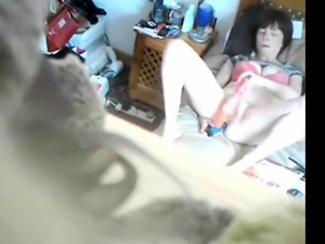 Girl uses two vibrators on hidden cam