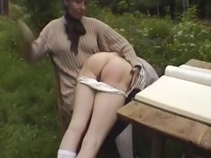 Grandmother spanks granddaughter outdoors xlx