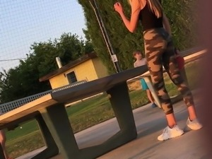 Sexy teen in tight leggings playing table tennis